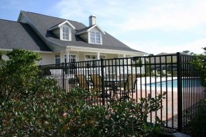 Home swimming pool in Kirkland surrounded by a wrought iron fence